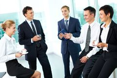 Business ties. Business people interacting with each other in semi-formal situation Stock Image