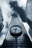 Business time. Watch on column surrounded by skyscrapers in London Royalty Free Stock Photos