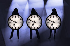 Business Time. Three modern businesswomen with a business clock Royalty Free Stock Image