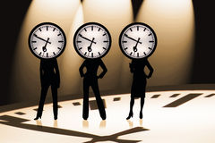 Business Time. Three modern businesswomen with a business clock Royalty Free Stock Photo