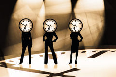 Business Time. Three modern businesswomen with a business clock Royalty Free Stock Images