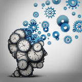 Business Time Planning. Thinking concept as a group of clock objects shaped as a human head with gears and cog wheels as the inside brain as a corporate Royalty Free Stock Photography