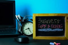 Business Tips & Tricks Planning on Background of Working Table with Office Supplies. stock images