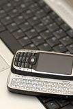 Business tools. Versatile mobile phone and laptop Royalty Free Stock Image