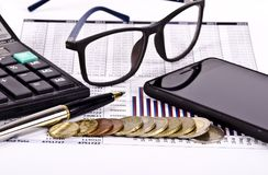 Business tools, calculator, pen and spectacles with money stock photos