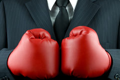 Business tough. Business boxing gloves (business tough Royalty Free Stock Photo