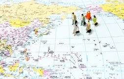 Business Tourism team. In the world map royalty free stock image