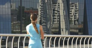Business tourism. Woman looks at high-riser stock footage