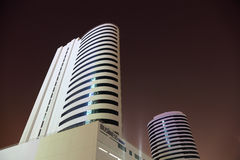 Business tower at night, Dubai Stock Photography