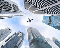 Business towers and aircraft Stock Photo