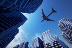Business towers with a airplane silhouette Stock Photography