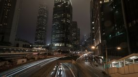 Business towers and traffic lights streak in city night, timelapse stock footage