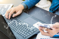 Business trading concept : man trade stock and forex by laptop Stock Photography