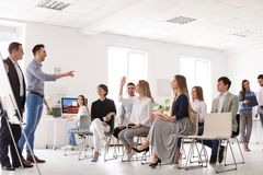 Business trainers giving lecture. In office stock photo