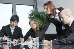 Business training. Businesspeople are discussing the work, or a salesperson or investment adviser is talking very friendly to female clients, good customer stock photography