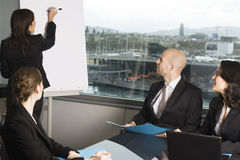 Business training. Businesspeople are discussing the work, or a salesperson or investment adviser is talking very friendly to female clients, good customer royalty free stock photos