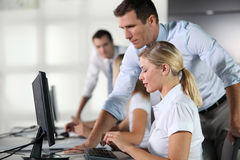 Business training. Business people working on computer royalty free stock photo