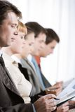 Business training. Profiles of business people with their leader in front stock images