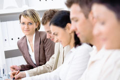Business training. Five business colleagues sitting in a row on a business presentation. Selective focus placed on woman in the background stock photo