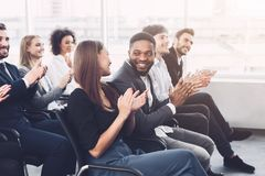 Business training. Colleagues clapping hands at seminar. Listening speaker royalty free stock photos