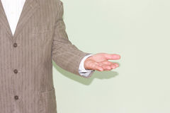 Business training concept. Photo for your. Design. Hand in profile with palm up. Concentration of money Stock Image