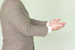 Business training concept. Photo for your design. The man is holding his hands in profile. In the position of capital accumulation Royalty Free Stock Photos