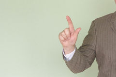Business training concept. Photo for your design. Man holds his hand. Thumb pressed Stock Photo