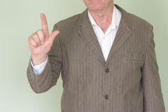 Business training concept. Photo for your design. Man holds his hand. Thumb pressed forward direction Stock Photos