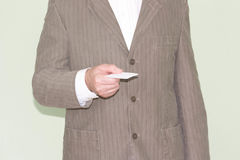 Business training concept. Photo for your design. Man holds a plastic bank card in his hand Stock Photography