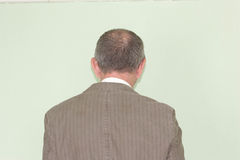 Business training concept. Photo for your design. The man is standing with his back. Looks into the distance Royalty Free Stock Photo