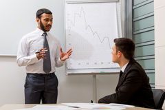 Business training. Teacher teaches the student royalty free stock photography
