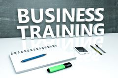 Business Training text concept. Business Training - text concept with chalkboard, notebook, pens and mobile phone. 3D render illustration Stock Photography