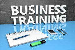 Business Training text concept. Business Training - text concept with chalkboard, notebook, pens and mobile phone. 3D render illustration Royalty Free Stock Photos