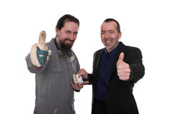 Business transaction. Craftsman and businessman agree on a contract Royalty Free Stock Photography