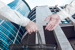 Business transfer deal. handover of a suitcase for money partners Stock Photo