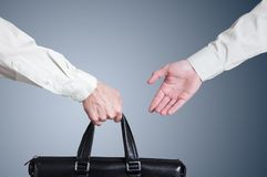 Business transfer deal. handover of a suitcase Stock Photography