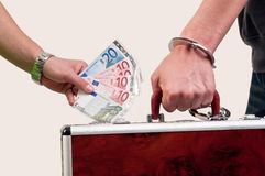 Business transfer deal. handover of a suitcase for money Stock Image