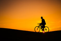 Business Transport with Bicycle in Sunset Stock Photos