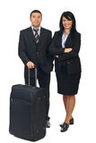 Business travel. Full length of two business people with luggage preparing to going in a business travel isolated on white background Stock Images