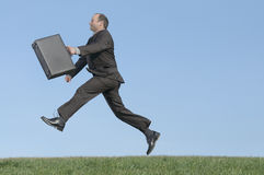 Business travel. Fast businessman with briefcase walking Stock Photography