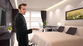 Business Travel. Young caucasian businessman in a 3d rendered hotel Stock Image