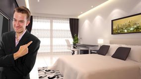 Business Travel. Young caucasian businessman in a 3d rendered hotel Royalty Free Stock Images