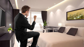 Business Travel. Young caucasian businessman in a 3d rendered hotel Royalty Free Stock Photos