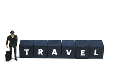 Business travel. A business traveller standing beside the word travel Stock Photos