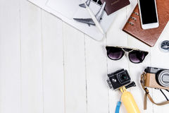 Business Travel Blogger objects and equipment. On white wooden copy space stock photo