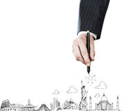 Business travel. Close up of businessman hand sketching images Royalty Free Stock Photos