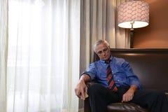 A Tired Senior Businessman Sleeping in Hotel Room stock photos