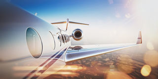Business travel concept.Generic design of white luxury private jet flying in blue sky at sunset.Uninhabited desert