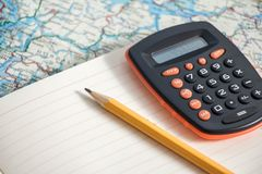 Business and travel concept. Orange calculator and pencil on book on map of Norway. Business and travel concept Royalty Free Stock Photos