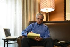 Businessman working in his hotel room royalty free stock photo